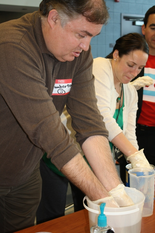 Humberto Rodriguez (Tonti) and Erin O'Neill (Everett) test the effects of icy water on insulated vs. non-insulated hands using Crisco to mimic polar bear fat.